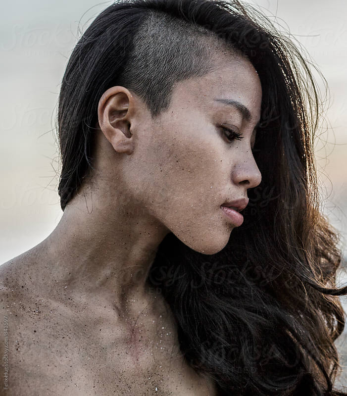 Portraiture of a young Asian woman by Felix Hug for Stocksy United