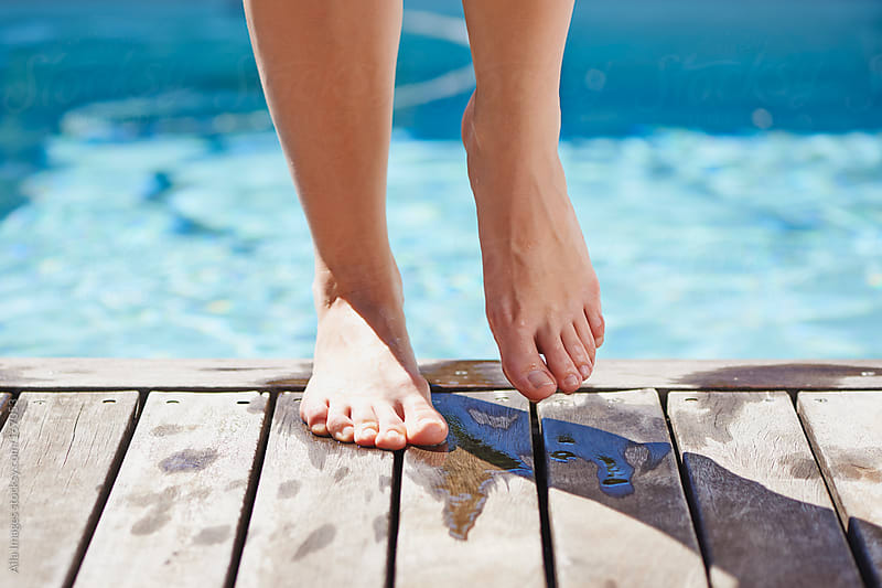 Feet at the pool by Aila Images for Stocksy United