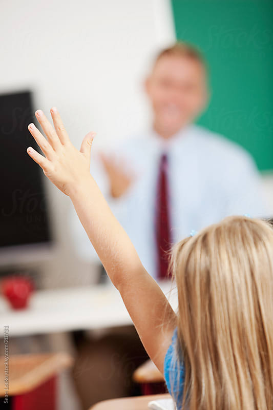 Classroom: Girl Raises Hand with Answers by Sean Locke for Stocksy United