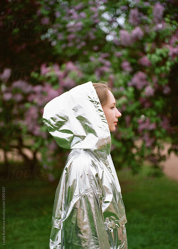 Woman in a silver raincoat by Lyuba Burakova for Stocksy United