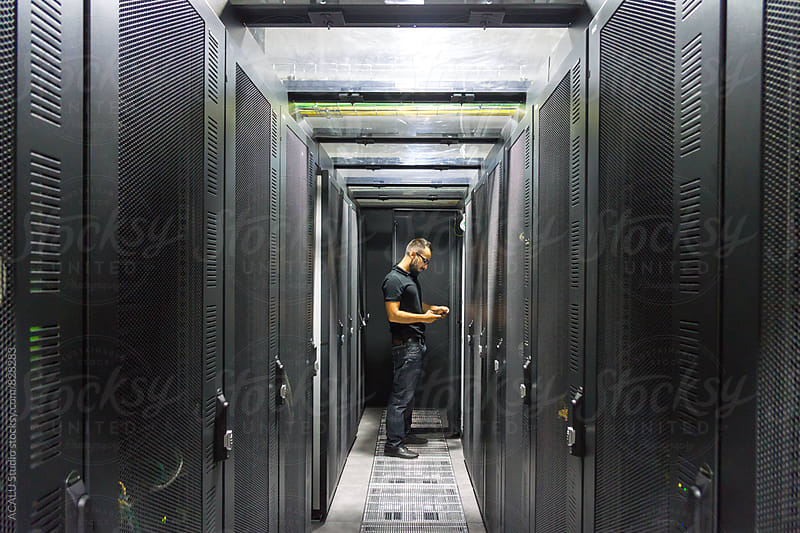 IT computer expert working on Network  by ACALU Studio for Stocksy United
