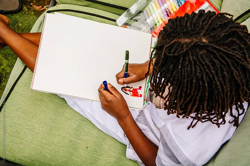 Black Girl Drawing by Gabriel (Gabi) Bucataru for Stocksy United