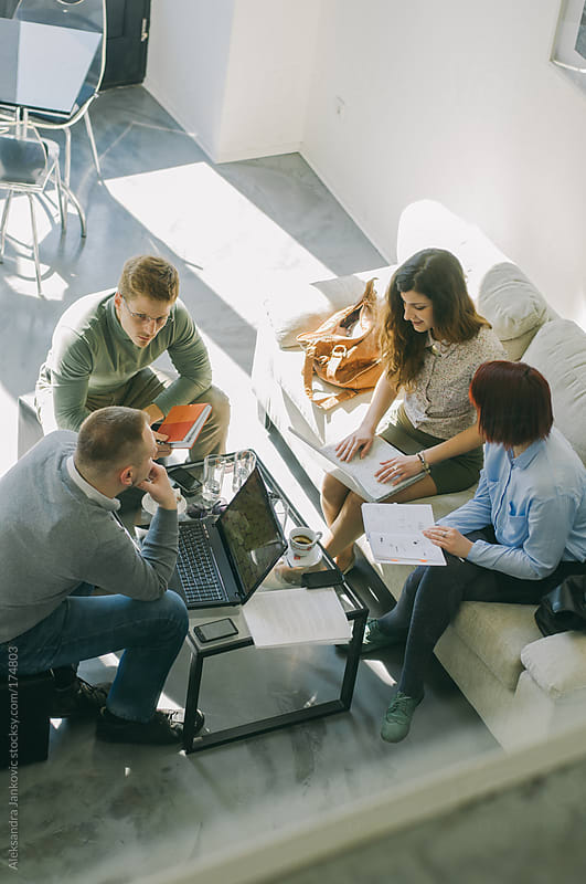 Young people in a business meeting by Aleksandra Jankovic for Stocksy United
