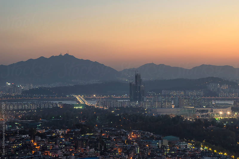 Panorama of Seoul at Twilight, South Korea by Tom Uhlenberg for Stocksy United