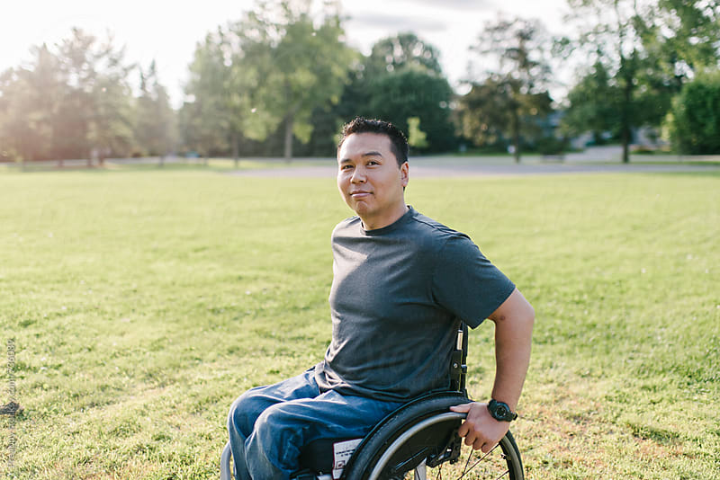 Portrait of a smiling man in wheelchair by Preappy for Stocksy United