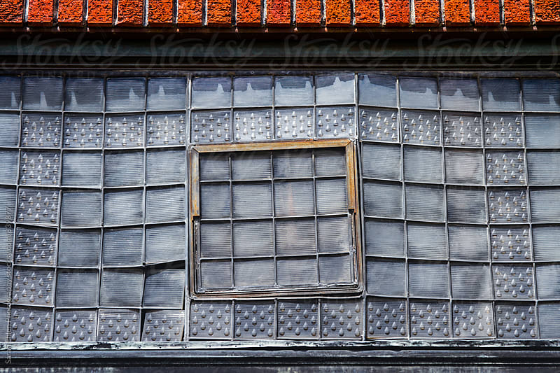 Closeup of windows in an old building by Sarah Ehlen Photography for Stocksy United