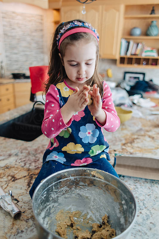Cute young girl making chocolate chip cookies by Jakob for Stocksy United