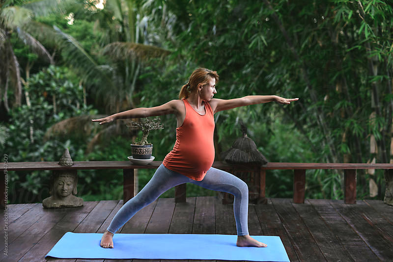 Pregnant Yoga by Alexander Grabchilev for Stocksy United
