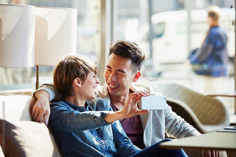 Couple Looking At Each Other While Talking Selfie by ALTO IMAGES for Stocksy United