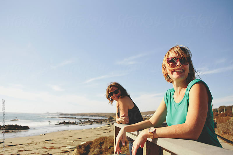 Female Friends at the Beach by Jayme Burrows for Stocksy United