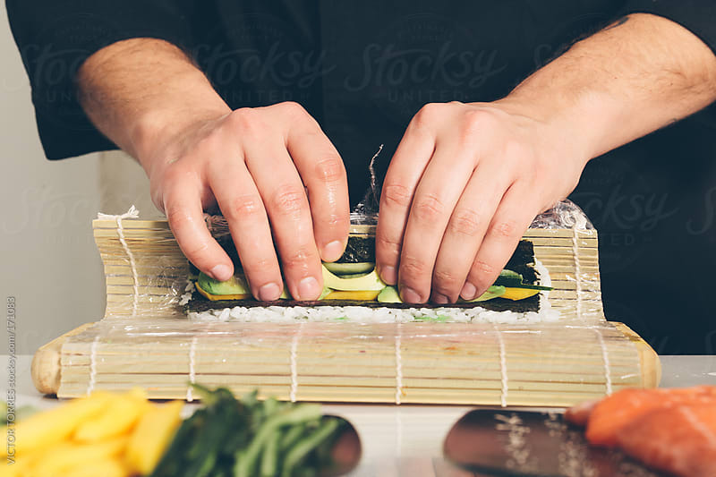 Chef Preparing Sushi by VICTOR TORRES for Stocksy United