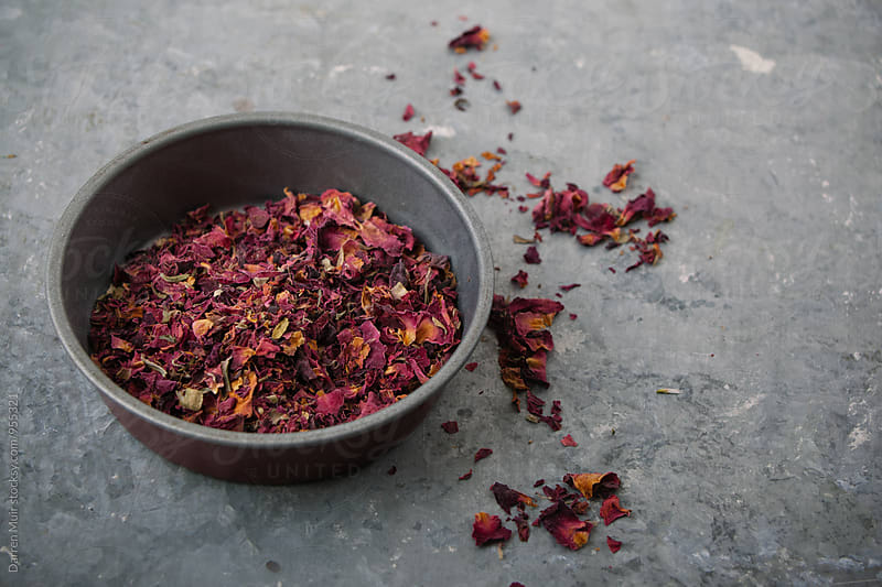 Dried rose petals in a bowl. by Darren Muir for Stocksy United