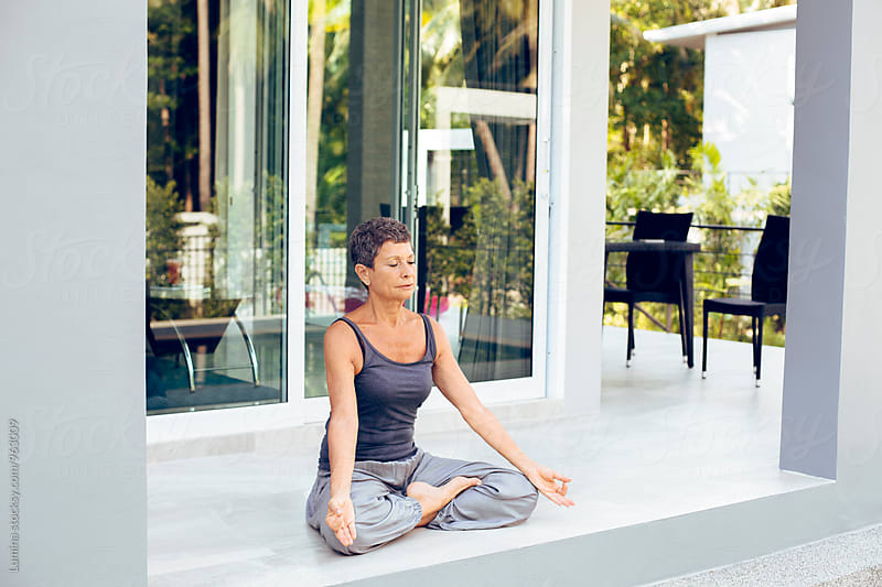 Senior Woman Meditating Outdoors