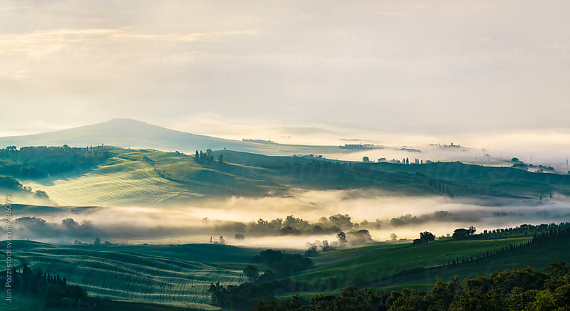 Tuscany hills at sunsrise by Juri Pozzi for Stocksy United