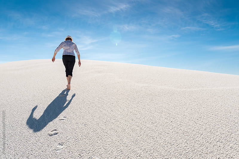 Woman Walking Up Sand Dune Barefoot In White Sands National Monument New Mexico by JP Danko for Stocksy United