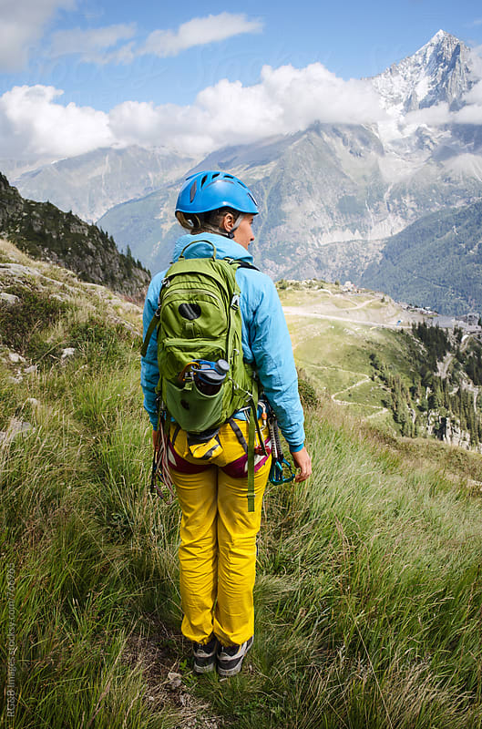 Woman wearing mountain equipment hiking in the French Alps by RG&B Images for Stocksy United