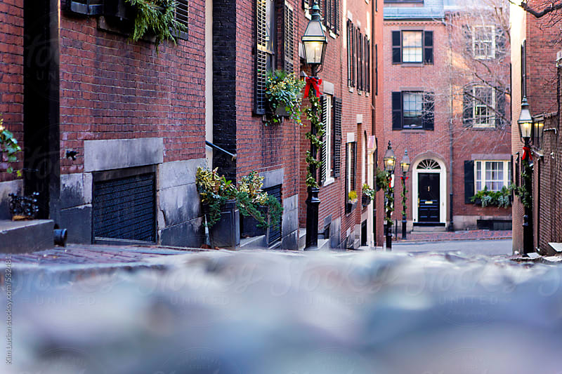 Cobblestone street from low perspective by Kim Lucian for Stocksy United