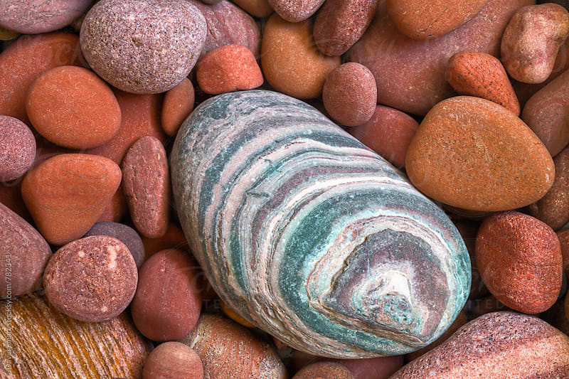 Colorful pebbles from the Flathead River  by David Smart for Stocksy United