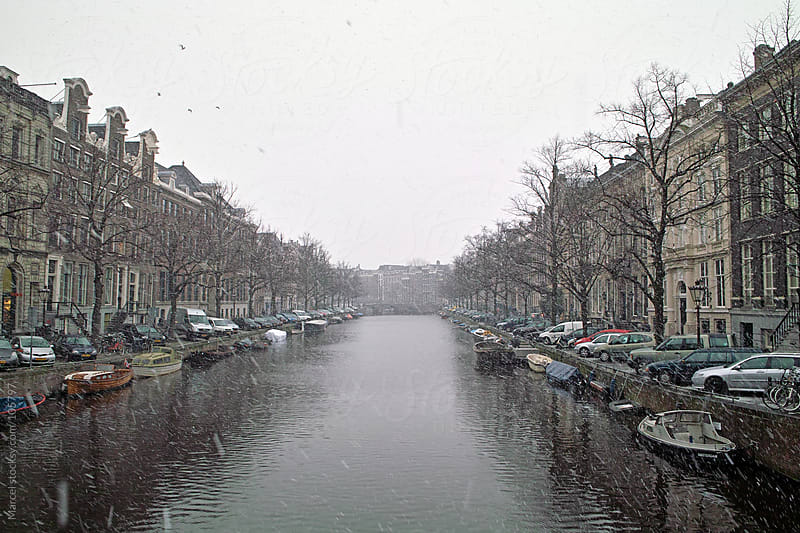 Amsterdam canal in the snow by Marcel for Stocksy United