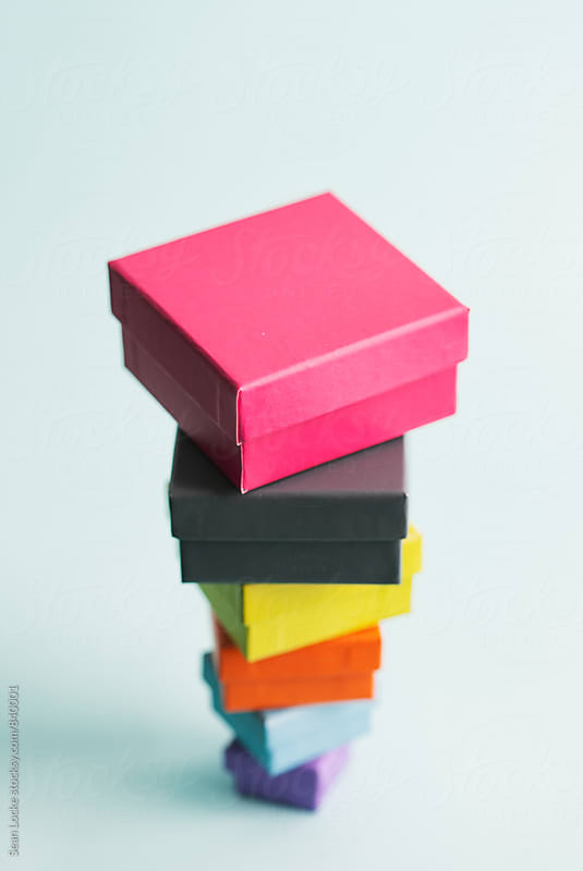 Inverted Stack Of Gift Boxes On Blue by Sean Locke for Stocksy United
