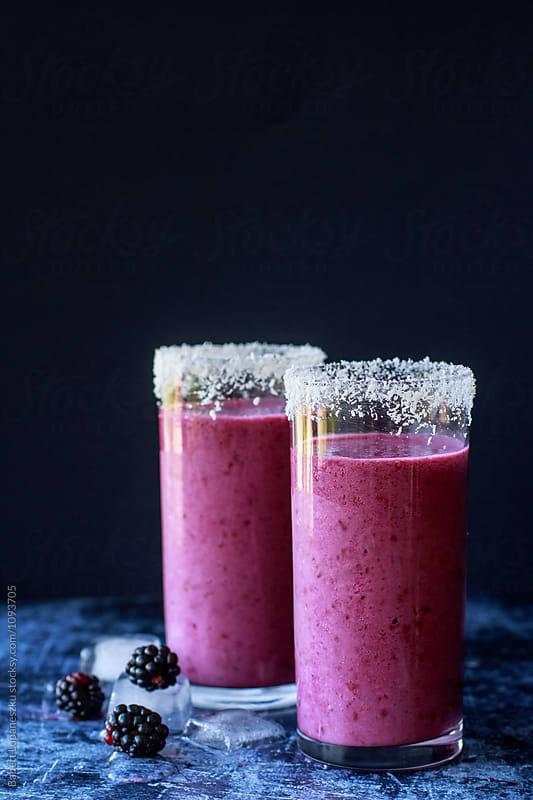 blackberry smoothie with coconut milk by Babett Lupaneszku for Stocksy United