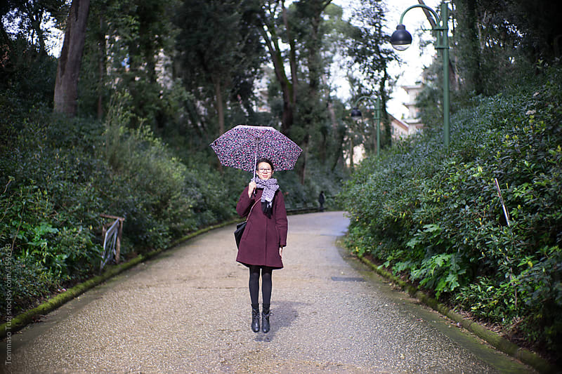 young girl with umbrella by Tommaso Tuzj for Stocksy United