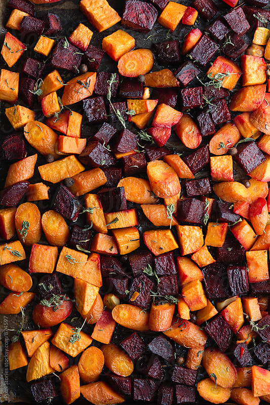 Roasted root vegetables by Pixel Stories for Stocksy United