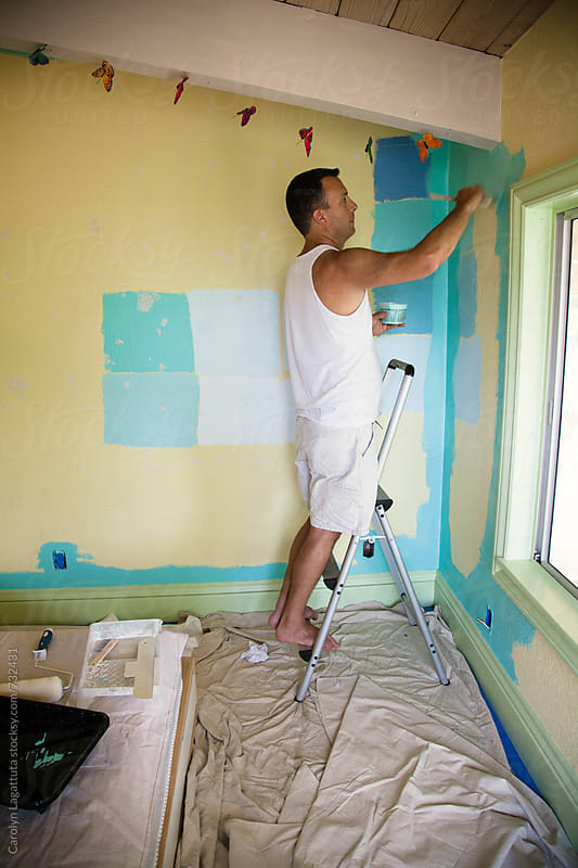 Man painting his teenage daughter's room by Carolyn Lagattuta for Stocksy United