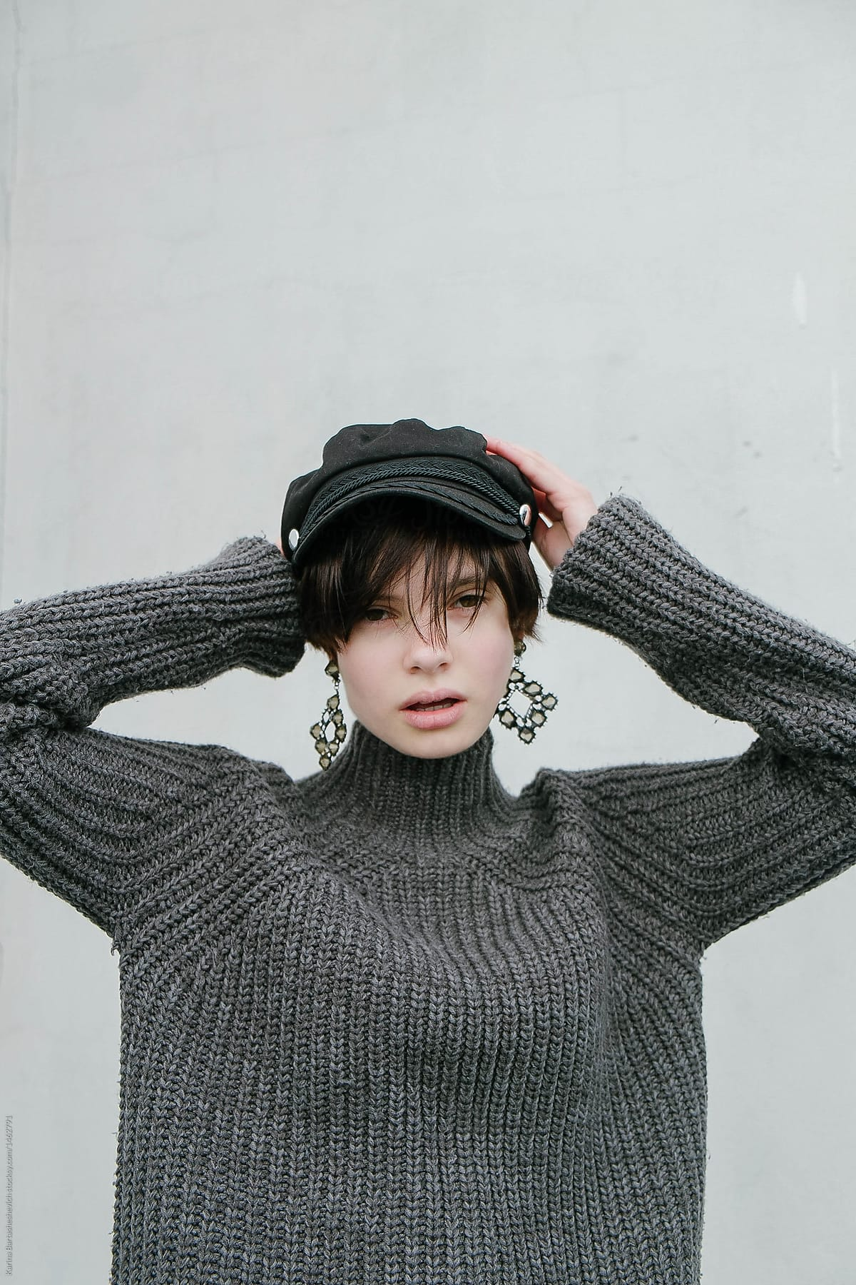 sophisticated young fashion girl with short hair with the hat with earrings f59c52e1ccb