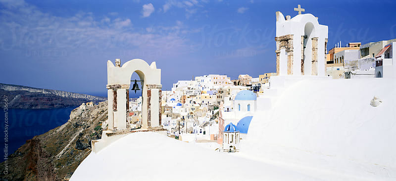 Blue domed churches in the village of Oia (La), Santorini (Thira), Cyclades Islands, Aegean Sea, Greece, Europe by Gavin Hellier for Stocksy United