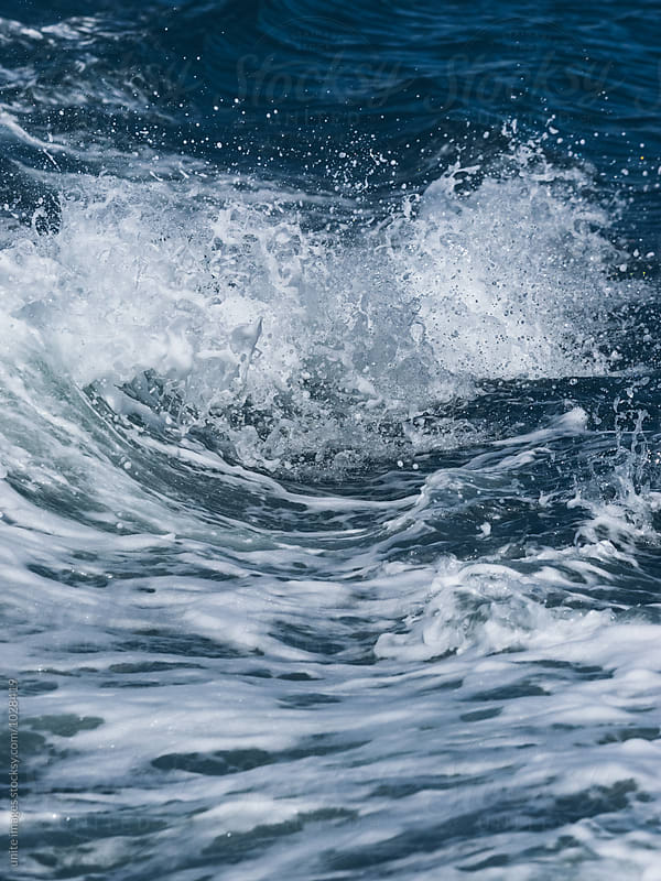 Wave crashing on water  by unite images for Stocksy United