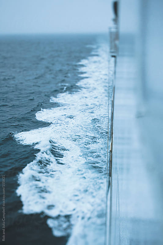 Waves from side of ferry boat sailing in winter by Rob and Julia Campbell for Stocksy United