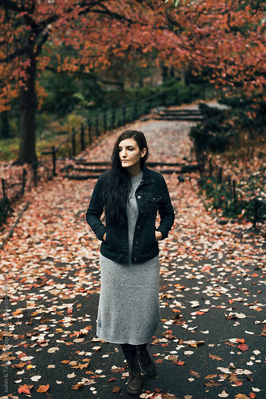 Woman standing alone in park by Isaiah & Taylor Photography for Stocksy United