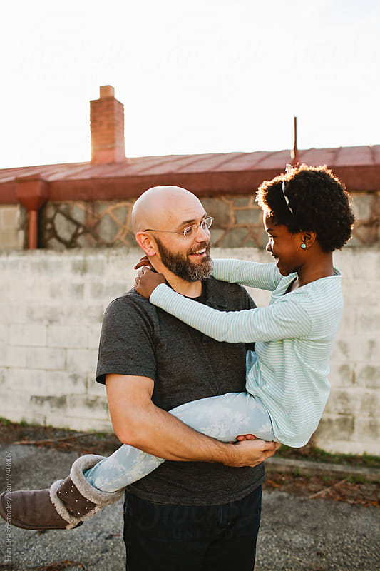 Dad and Apdopted Daughter by Erin Drago for Stocksy United