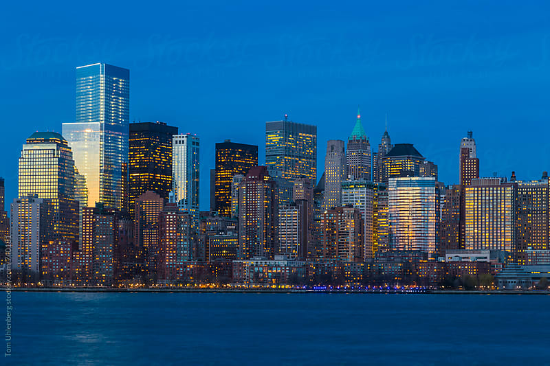 New York City - Lower Manhattan Skyline at Night by Tom Uhlenberg for Stocksy United
