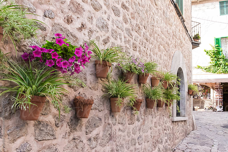 Beautiful mediterranean decoration on a wall in the historic village of Valldemosa in Majorca by Marilar Irastorza for Stocksy United