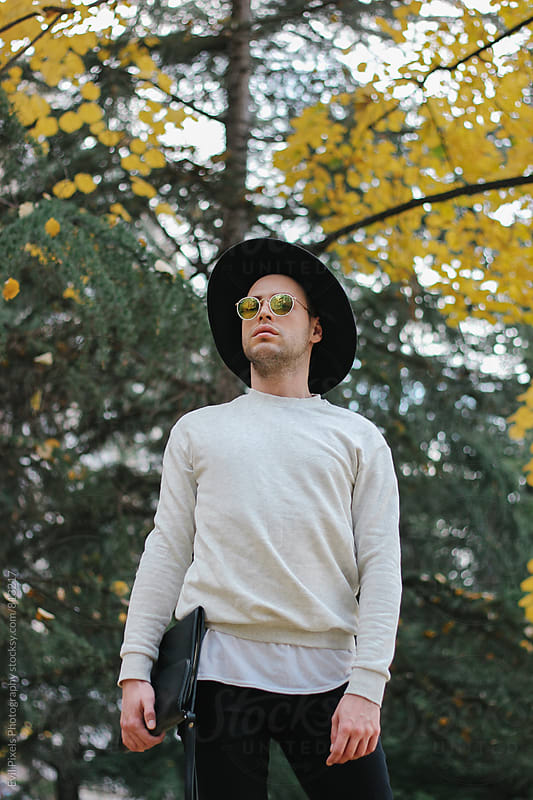 Male model with hat and sunglasses in park by Evil Pixels  Photography for Stocksy United