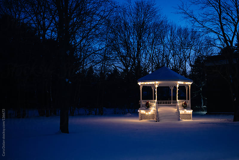 Gazebo lit up for Christmas by Cara Dolan for Stocksy United