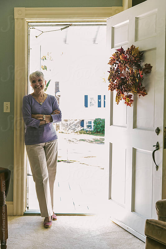 Senior Woman In Doorway by Raymond Forbes LLC for Stocksy United