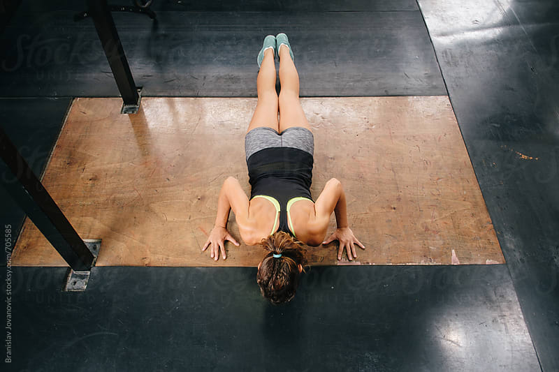 Woman Doing Pushups at the Gym by Branislav Jovanović for Stocksy United