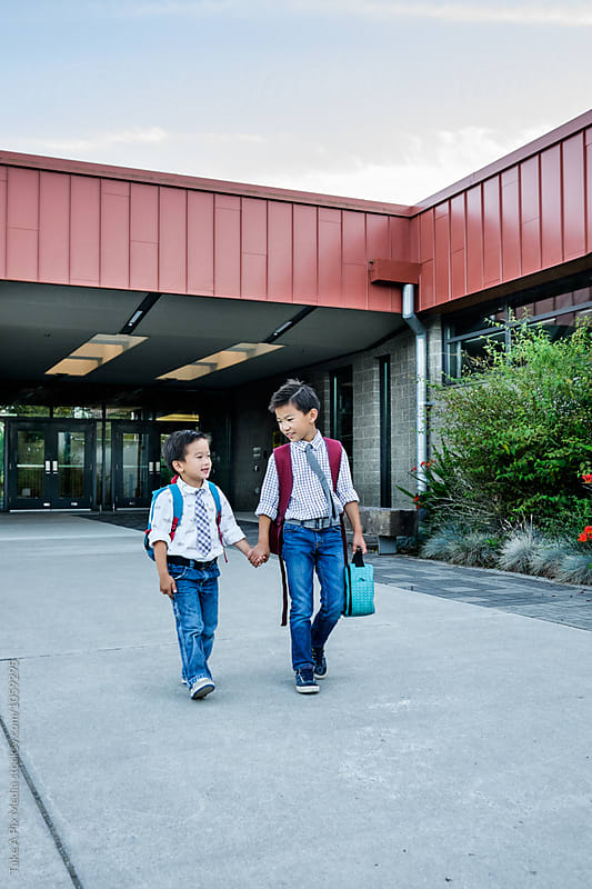 Back to school: Asian kids walking in school by Suprijono Suharjoto for Stocksy United