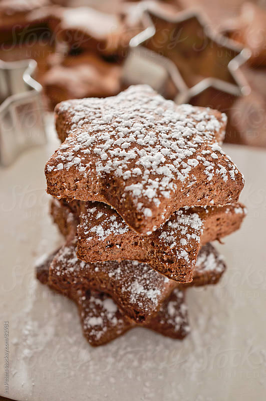 Food: Stacked star shaped chocolate cookies  by Ina Peters for Stocksy United