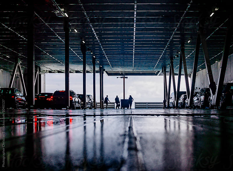 Wet car deck of a ferry by Photographer Christian B for Stocksy United