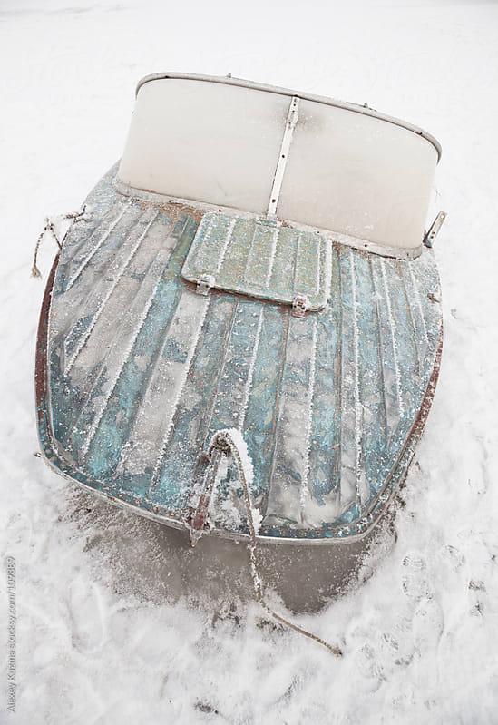 frozen boat by Alexey Kuzma for Stocksy United