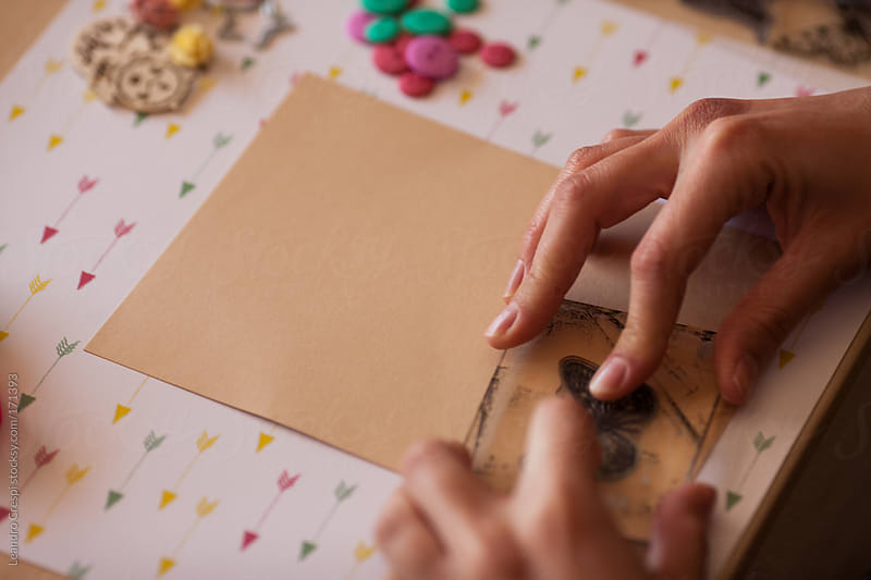 woman making scrapbook design by Leandro Crespi for Stocksy United