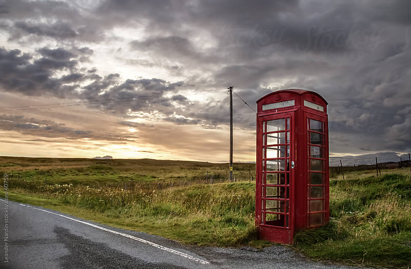 Old phone box in the middle of nowhere by Leander Nardin for Stocksy United