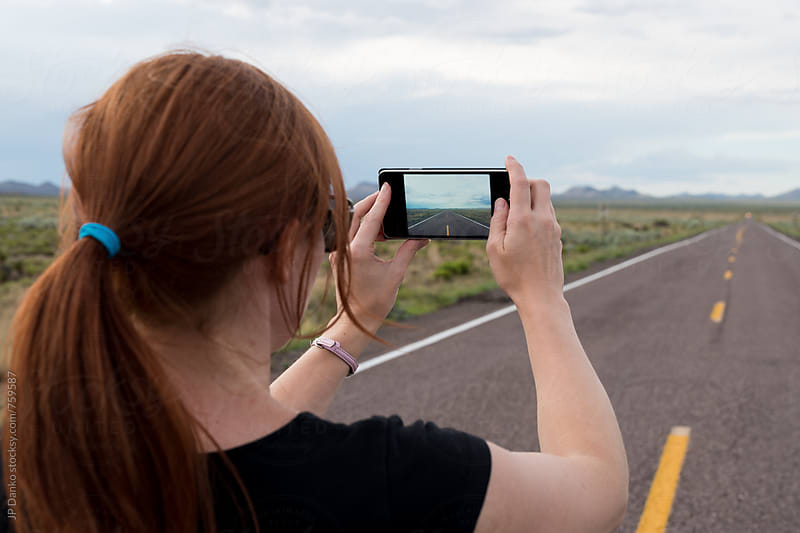 Woman Taking Mobile Phone Photo of Road To Trinity Nuclear Bomb Test Site New Mexico USA by JP Danko for Stocksy United