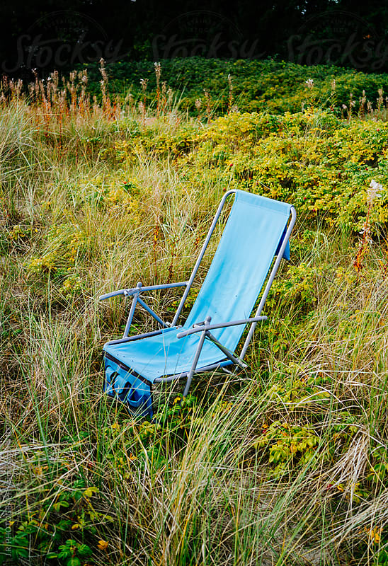 Lounge Chair in the meadow by J.R. PHOTOGRAPHY for Stocksy United