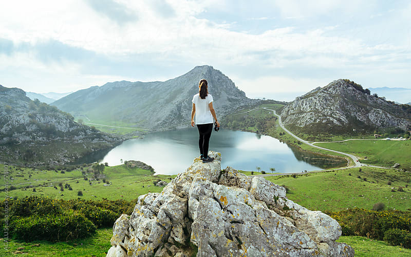 Young woman looking at the lake by ACALU Studio for Stocksy United