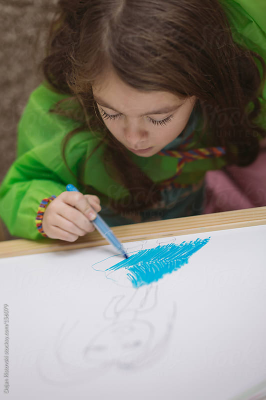 Child drawing  by Dejan Ristovski for Stocksy United